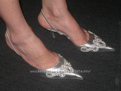 новые серебристые туфельки 39 размера,