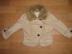 Продам модную курточку из натуральной замши на 2 года.