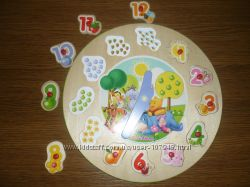 Развивающая  деревянная игрушка Часики немецкой марки