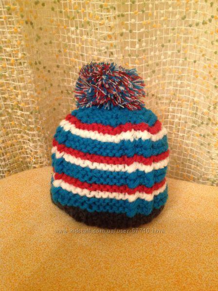 Яркая полосатая шапочка для незабываемой зимней прогулки.