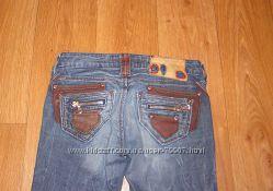 Эффектные стильные джинсы с кожаными вставками