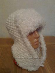 Теплая зимняя шапка-ушанка всегда согрее свою хозяйку
