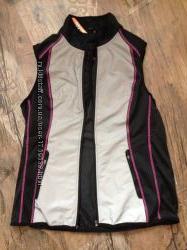 Продам светоотражающую женскую спортивную жилетку